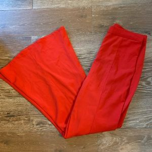 Red flare pants